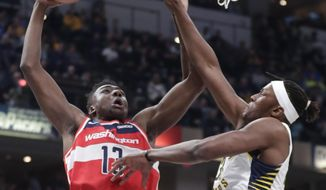Washington Wizards center Thomas Bryant (13) shoots over Indiana Pacers center Myles Turner (33) during the first half of an NBA basketball game in Indianapolis, Monday, Dec. 10, 2018. (AP Photo/Michael Conroy)
