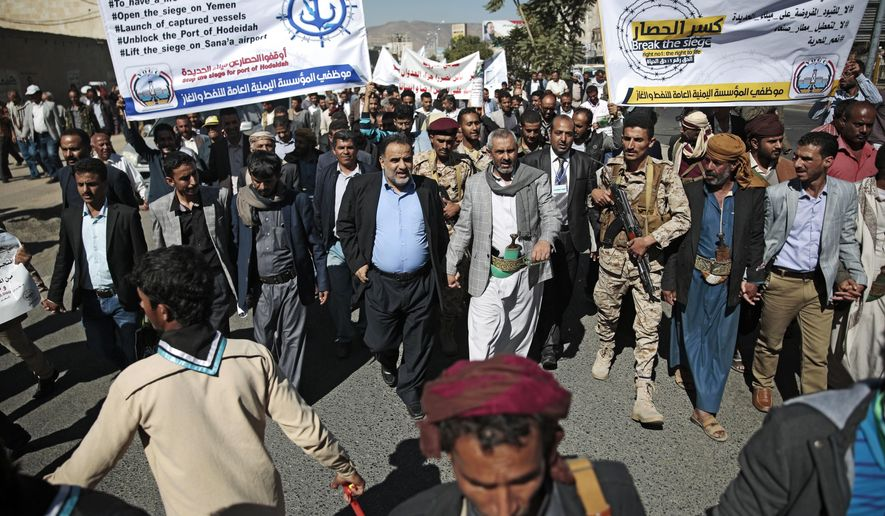 Yemenis hold banners as they take part in a protest calling for the reopening of Sanaa airport to receive medical aid, in front of the U.N. offices in Sanaa, Yemen, Monday, Dec. 10, 2018. (AP Photo/Hani Mohammed)