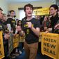 Jeremy Ornstein of Watertown, Mass., center, cheers on fellow environmental activists as they occupy the office of Rep. Steny Hoyer, D-Md., the incoming majority leader, as they try to pressure Democratic support for a sweeping agenda to fight climate change, on Capitol Hill in Washington, Monday, Dec. 10, 2018. (AP Photo/J. Scott Applewhite) ** FILE **