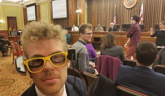 Photo by Julia Airey / The Washington Times      Rob Dooling, a deaf Advisory Neighborhood Commissioner, wears a pair of mock captioning glasses he made for a D.C. Council hearing on Dec. 11, 2018. Lawmakers are considering legislation that would require movie theaters to screen more films with open captioning after deaf and hard-of-hearing viewers. Advocates say that many captioning glasses are broken or too heavy to wear comfortably. (Photo by Julia Airey)