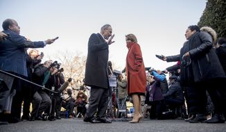 House Minority Leader Nancy Pelosi of Calif. and Senate Minority Leader Sen. Chuck Schumer of N.Y. walk back into the West Wing after speaking to members of the media outside of the White House in Washington, Tuesday, Dec. 11, 2018, following a meeting with President Donald Trump. (AP Photo/Andrew Harnik)