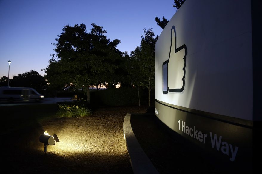"File - In this Jun 7, 2013, file photo, the Facebook ""like"" symbol is illuminated on a sign outside the company's headquarters in Menlo Park, Calif. Facebook is having one of its worst weeks as a publicly traded company with a share sell-off continuing for a second day. Britain's Commissioner Elizabeth Denham told the BBC that she was investigating Facebook and has asked the company not to pursue its own audit of Cambridge Analytica's data use. Denham is also pursuing a warrant to search Cambridge Analytica's servers. (AP Photo/Marcio Jose Sanchez, File)"