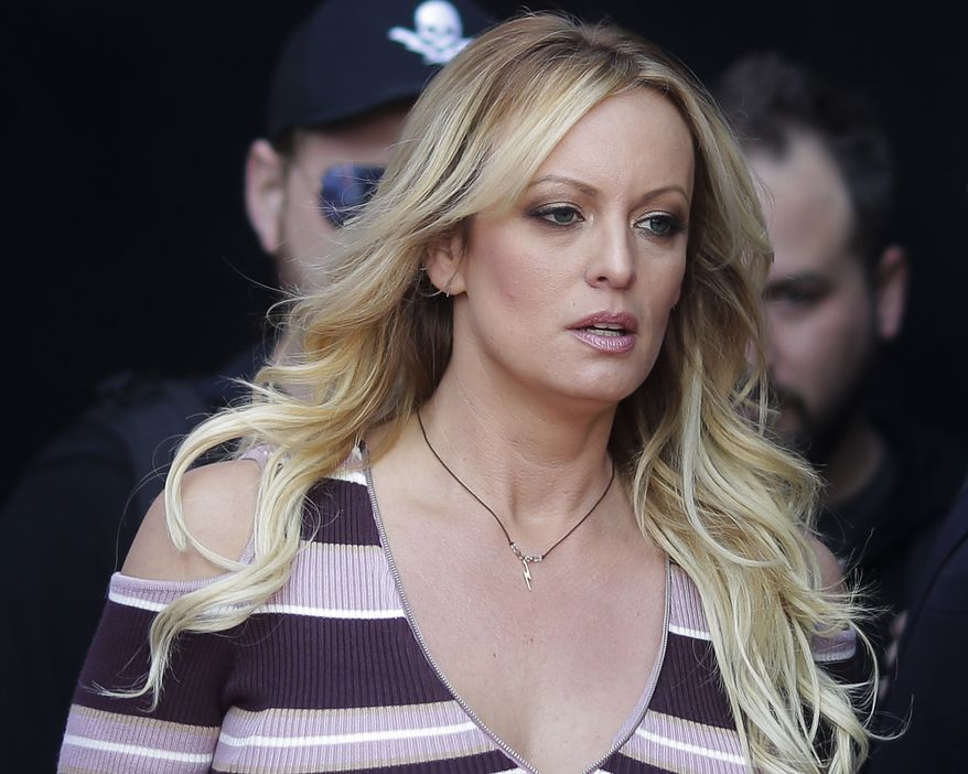 "In this Oct. 11, 2018, file photo, adult film actress Stormy Daniels arrives for the opening of the adult entertainment fair ""Venus,"" in Berlin. (AP Photo/Markus Schreiber, File)"