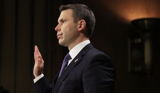 Customs and Border Protection Commissioner Kevin McAleenan is sworn in before a Senate Judiciary Committee hearing on 'Oversight of U.S. Customs and Border Protection' on Capitol Hill in Washington, Tuesday, Dec. 11, 2018. (AP Photo/Manuel Balce Ceneta)