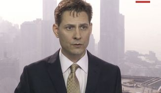 In this image made from a video taken on March 28, 2018, Michael Kovrig, an adviser with the International Crisis Group, a Brussels-based non-governmental organization, speaks during an interview in Hong Kong. Canadian Public Safety Minister Ralph Goodale confirmed on Tuesday, Dec. 11, 2018, that Kovrig, a former Canadian diplomat, was arrested Monday night in Beijing, China. The arrest comes amid a dispute between the two counties over Canada's arrest of a Chinese executive at the request of the United States. (AP Photo)