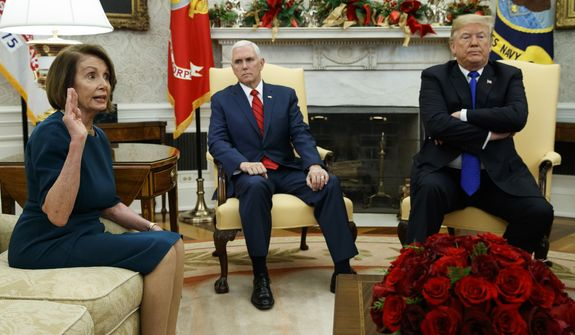 Vice President Mike Pence, center, listens as President Donald Trump argues with House Minority Leader Rep. Nancy Pelosi, D-Calif., during a meeting in the Oval Office of the White House, Tuesday, Dec. 11, 2018, in Washington. (AP Photo/Evan Vucci)