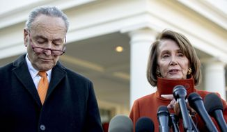 House Minority Leader Nancy Pelosi of Calif., right, accompanied by Senate Minority Leader Sen. Chuck Schumer of N.Y., left, speaks to members of the media outside the West Wing of the White House in Washington, Tuesday, Dec. 11, 2018, following a meeting with President Donald Trump. (AP Photo/Andrew Harnik)
