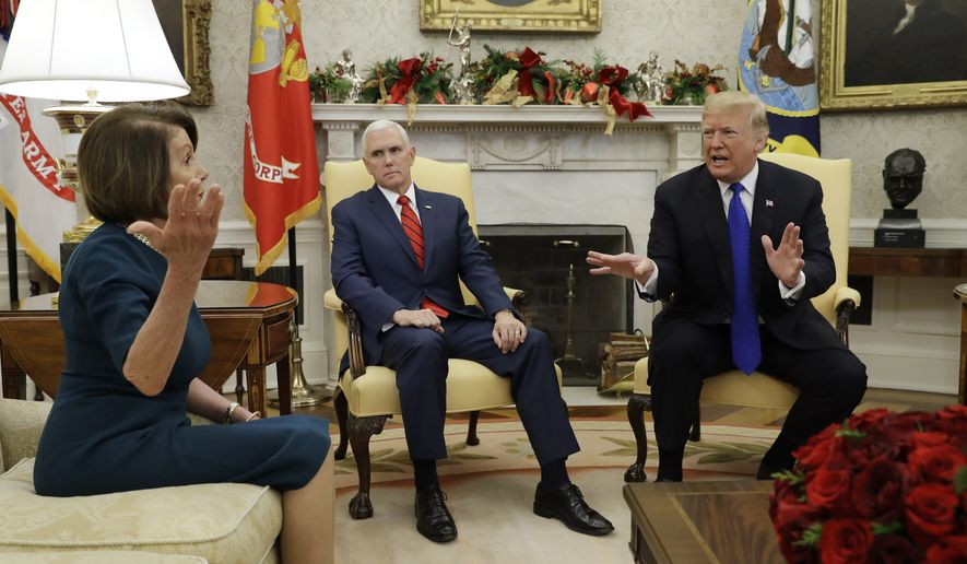 President Donald Trump and Vice President Mike Pence, meet with House Minority Leader Nancy Pelosi, D-Calif., left, and Senate Minority Leader Chuck Schumer, D-N.Y., not shown, in the Oval Office of the White House, Tuesday, Dec. 11, 2018, in Washington. (AP Photo/Evan Vucci) **FILE**