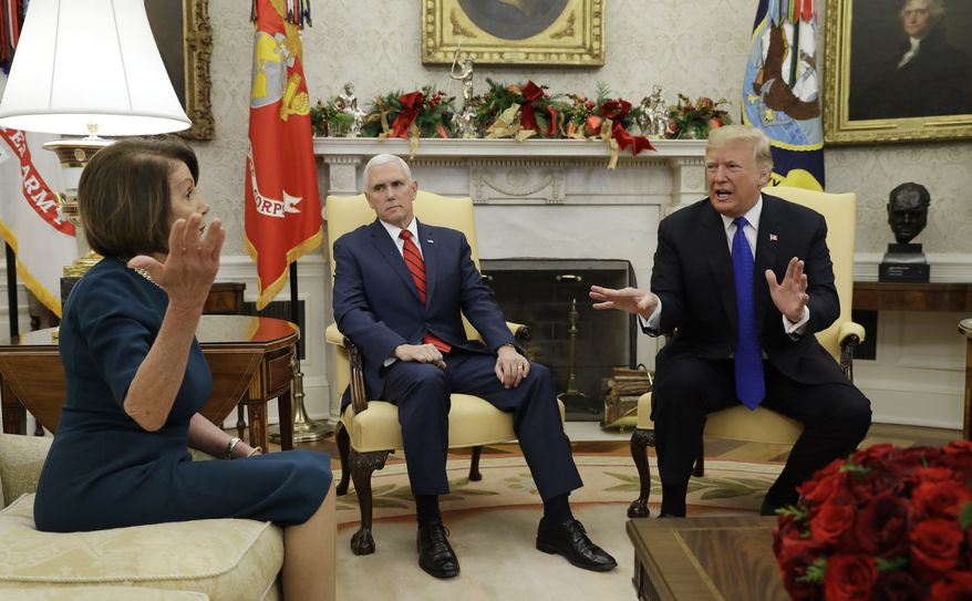 President Donald Trump and Vice President Mike Pence, meet with House Minority Leader Nancy Pelosi, D-Calif., left, and Senate Minority Leader Chuck Schumer, D-N.Y., not shown, in the Oval Office of the White House, Tuesday, Dec. 11, 2018, in Washington. (AP Photo/Evan Vucci)