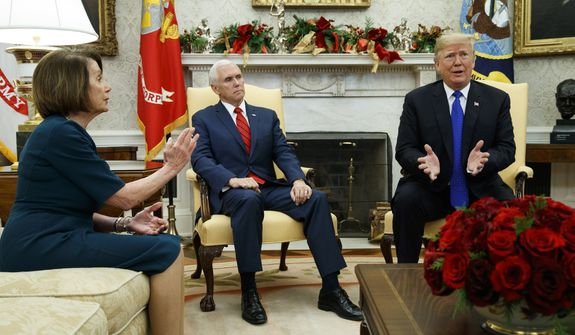 Vice President Mike Pence, center, looks on as House Minority Leader Rep. Nancy Pelosi, D-Calif., and President Donald Trump speak during a meeting in the Oval Office of the White House, Tuesday, Dec. 11, 2018, in Washington. (AP Photo/Evan Vucci)