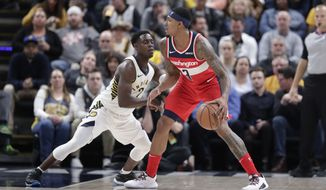 Washington Wizards guard Bradley Beal (3) drives on Indiana Pacers guard Darren Collison (2) during the second half of an NBA basketball game in Indianapolis, Monday, Dec. 10, 2018. The Pacers defeated the Wizards 109-101. (AP Photo/Michael Conroy) ** FILE **