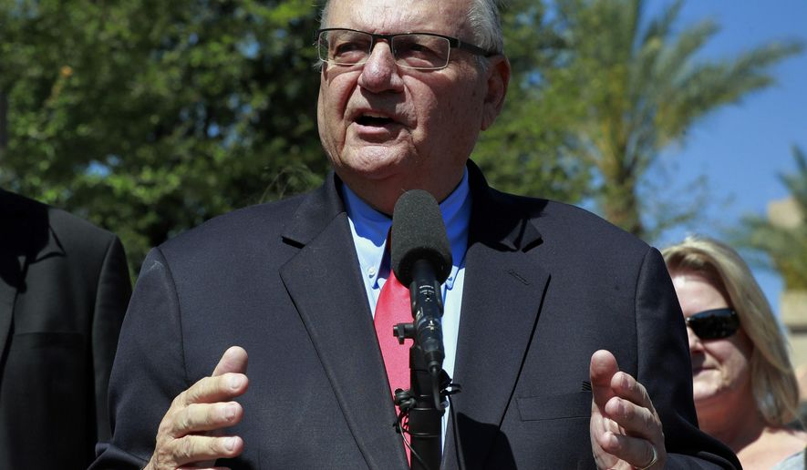 FILE _ In this May 22, 2018, file photo, former Maricopa County Sheriff Joe Arpaio speaks during a campaign event in Phoenix. Arpaio filed a defamation lawsuit against three news organizations on Monday, Dec. 10, alleging that their inaccurate references to his criminal case have hurt his chances in possibly running in 2020 for the Senate. (AP Photo/Matt York, File)