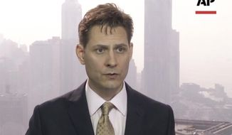 In this image made from a video taken on March 28, 2018, North East Asia senior adviser Michael Kovrig speaks during an interview in Hong Kong. A former Canadian diplomat reportedly has been arrested in China. The International Crisis Group said Tuesday, Dec. 11 it's aware of reports that its North East Asia senior adviser Michael Kovrig has been detained. (AP Photo)