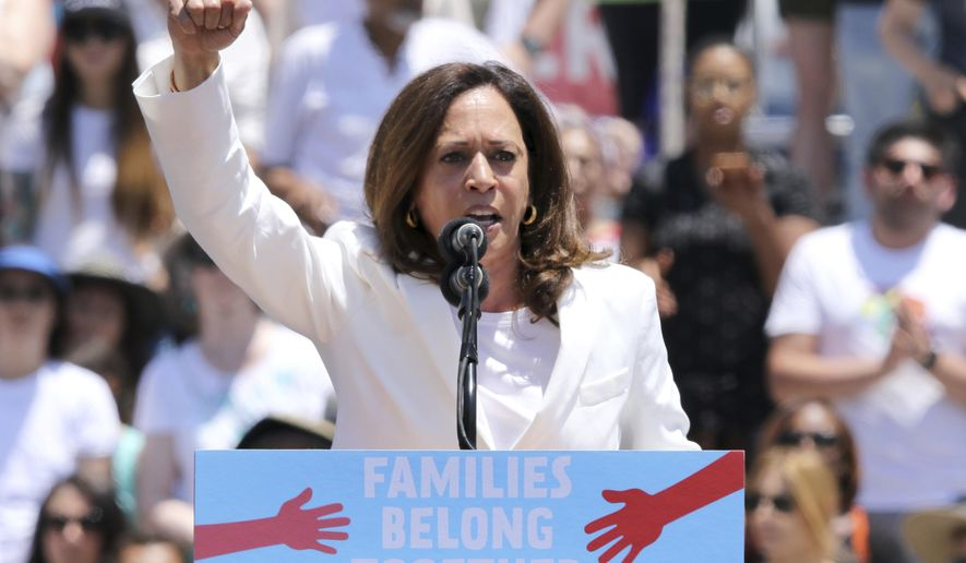 """In this June 30, 2018, file photo, U.S. Sen. Kamala Harris, D-Calif., speaks at the """"Families Belong Together: Freedom for Immigrants"""" March in Los Angeles. (Photo by Willy Sanjuan/Invision/AP, File)"""