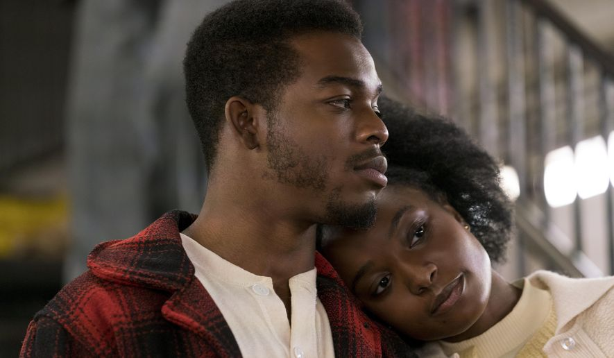 """This image released by Annapurna Pictures shows Stephan James, left, and KiKi Layne in a scene from """"If Beale Street Could Talk."""" (Tatum Mangus/Annapurna Pictures via AP)"""