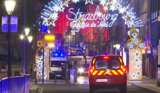 In this image made from video, emergency services arrive on the scene of a Christmas market in Strasbourg, France, Tuesday, Dec. 11, 2018. A French regional official says that a shooting in Strasbourg has left at least one dead and several wounded in the city center near a world-famous Christmas market. The prefect of France's Bas-Rhin region says the gunman, who is still at large, has been identified. Authorities haven't given a motive for the shooting. (AP Photo)