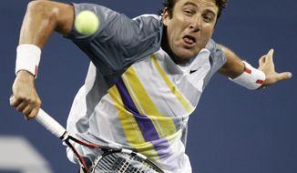 FILE - In this Aug. 28, 2007 file photo, Justin Gimelstob returns a shot to Andy Roddick at the US Open tennis tournament in New York. Now a tennis broadcaster and coach, Gimelstob faces a felony assault charge following his Halloween night arrest for allegedly attacking former friend Randall Kaplan in Los Angeles. The 41-year-old former pro player is scheduled to appear in court Wednesday, Dec. 18, 2018. (AP Photo/Ed Betz, File)