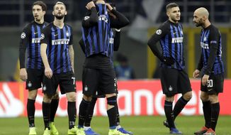 Inter's players react at the end of the Champions League, Group B soccer match between Inter Milan and PSV Eindhoven, at the San Siro stadium in Milan, Italy, Tuesday, Dec. 11, 2018. The game ended 1-1. (AP Photo/Luca Bruno)