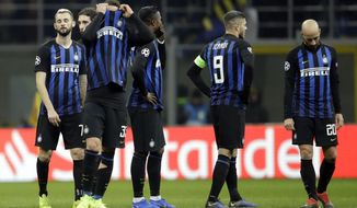 Inter Milan's players react at the end of the Champions League, Group B soccer match between Inter Milan and PSV Eindhoven, at the San Siro stadium in Milan, Italy, Tuesday, Dec. 11, 2018. (AP Photo/Luca Bruno)