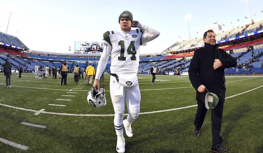 New York Jets quarterback Sam Darnold leaves the field after an NFL football game against the Buffalo Bills, Sunday, Dec. 9, 2018, in Orchard Park, N.Y. (AP Photo/Adrian Kraus)