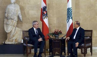Lebanese President Michel Aoun, right, meets with his Austrian counterpart Alexander Van Der Bellen, at the Presidential Palace in Baabda, east of Beirut, Lebanon, Tuesday, Dec. 11, 2018. (AP Photo/Bilal Hussein)