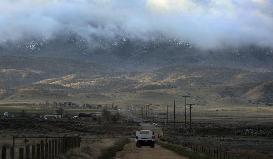 FILE - In March 26, 2011, file photo, threatening clouds are seen at sunrise on Tejon Ranch near Gorman, Calif. A 19,000 home development planned in fire-prone mountains on the outskirts of Los Angeles County faces a final vote from county supervisors on Tuesday, Dec. 11, 2018. The decision comes as critics draw attention to the high fire hazard in the area as the state recovers from deadly and devastating wildfires in Northern and Southern California and tries to solve a major housing crisis. (AP Photo/David McNew, File)