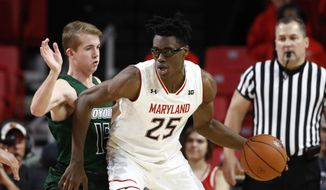 Maryland forward Jalen Smith (25) drives against Loyola-Maryland guard Sam Norton in the first half of an NCAA college basketball game, Tuesday, Dec. 11, 2018, in College Park, Md. (AP Photo/Patrick Semansky) 