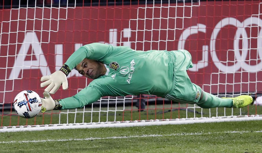 FILE - In this Nov. 29, 2017, file photo, Columbus Crew goalkeeper Zack Steffen makes a save on a penalty kick from Toronto FC midfielder Victor Vazquez, not shown, during the first half of an Eastern Conference MLS final playoff soccer game in Toronto. American goalkeeper Zack Steffen will transfer to Manchester City from the Columbus Crew in July. The Crew said Tuesday, Dec. 11, 2018, that Steffen will join City when the summer transfer window opens July 9.(Mark Blinch/The Canadian Press via AP, File)
