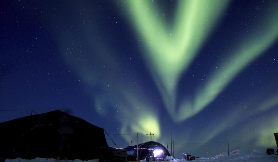 FILE - In this March 9, 2018, file photo provided by the U.S. Navy, the aurora borealis displays above Ice Camp Skate in the Beaufort Sea during Ice Exercise (ICEX) 2018. Scientists are seeing surprising melting in Earth's polar regions at times they don't expect, like winter, and in places they don't expect, like eastern Antarctica. (MC 2nd Class Micheal H. Lee/U.S. Navy via AP, File)