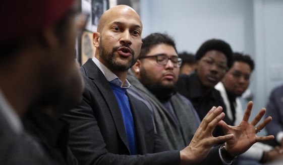 Actor Keegan-Michael Key speaks with Wayne State University students at the Motown Museum in Detroit, Tuesday, Dec. 11, 2018. Former First Lady Michelle Obama surprised the students and spoke during the conversation. (AP Photo/Paul Sancya)