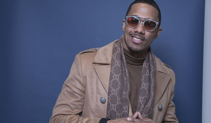 "In this Dec. 10, 2018 photo, Nick Cannon poses for a portrait in New York to promote promoting his new show, ""The Masked Singer."" (Photo by Amy Sussman/Invision/AP)"