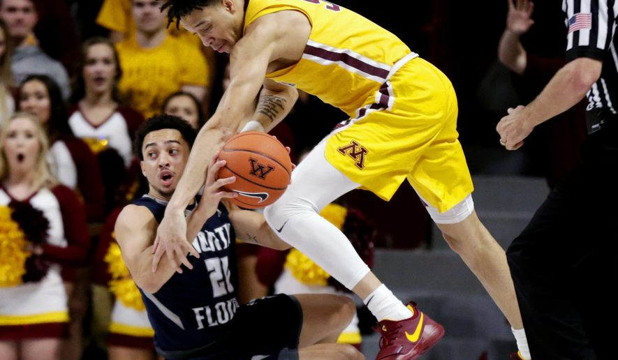 North Florida guard Brian Coffey II (20) looks to pass as Minnesota guard Amir Coffey (5) reaches in during the first half of an NCAA college basketball game Tuesday, Dec. 11, 2018, in Minneapolis. (AP Photo/Andy Clayton-King)