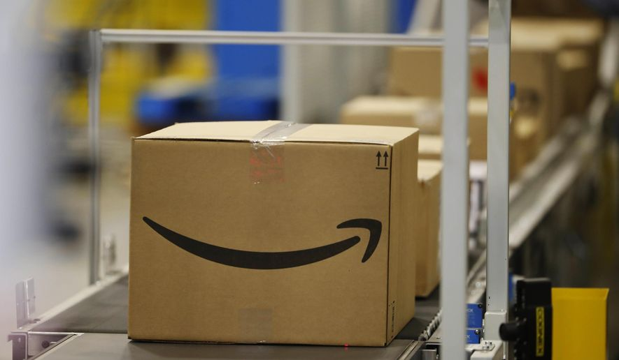 This May 3, 2018, photo shows boxes on a conveyor belt during a tour of the Amazon fulfillment center in Aurora, Colo. The explosion in online shopping has led to porch pirates and stoop surfers swiping holiday packages from unsuspecting residents. The cops in one New Jersey city are trying to catch the thieves with some trickery of their own. (AP Photo/David Zalubowski)