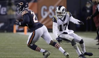Chicago Bears cornerback Prince Amukamara (20) intercepts a pass intended for Los Angeles Rams receiver Robert Woods (17) during the second half of an NFL football game against the Los Angeles Rams Sunday, Dec. 9, 2018, in Chicago. (AP Photo/Nam Y. Huh)