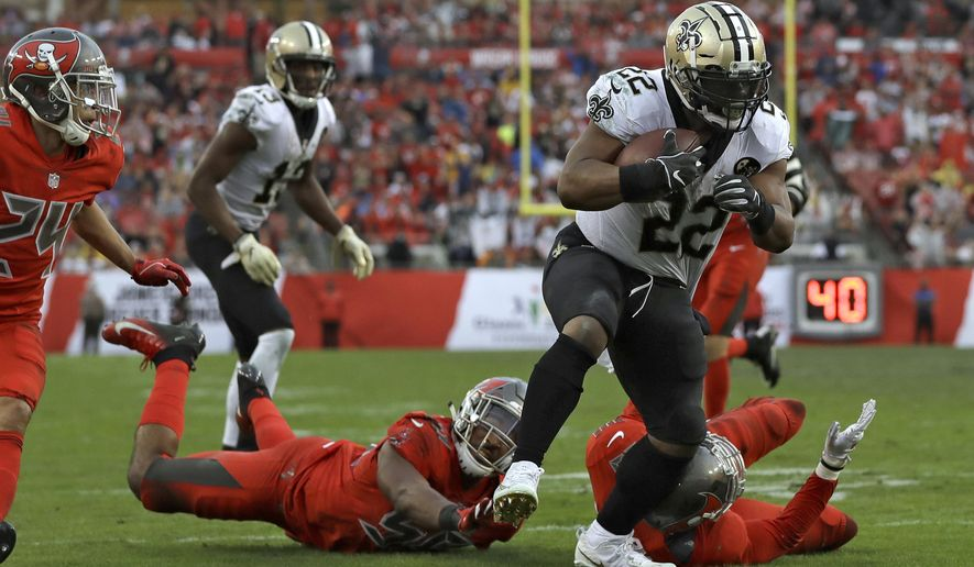 New Orleans Saints running back Mark Ingram (22) breaks through the Tampa Bay Buccaneers defense on a 17-yard touchdown run during the second half of an NFL football game Sunday, Dec. 9, 2018, in Tampa, Fla. (AP Photo/Mark LoMoglio)