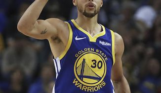Golden State Warriors' Stephen Curry celebrates a score against the Minnesota Timberwolves in the second half of an NBA basketball game, Monday, Dec. 10, 2018, in Oakland, Calif. (AP Photo/Ben Margot)