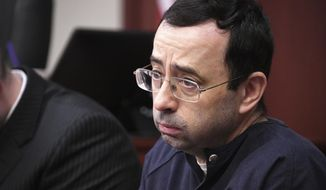FILE - In this Tuesday, Jan. 23, 2018, file photo, Larry Nassar looks at the gallery in the court during the sixth day of his sentencing hearing in Lansing, Mich. The 233 pages of details about how Olympic leaders and the FBI responded, or didn't, to sex-abuse allegations against Nassar was yet another entry in an endless exercise in looking backward to respond to a crisis that needs some new ideas and better execution before anything is truly fixed. (Dale G. Young/Detroit News via AP, File)