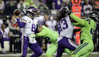 Minnesota Vikings quarterback Kirk Cousins (8) is pressured by Seattle Seahawks' Akeem King in the first half of an NFL football game, Monday, Dec. 10, 2018, in Seattle. (AP Photo/Ted S. Warren)