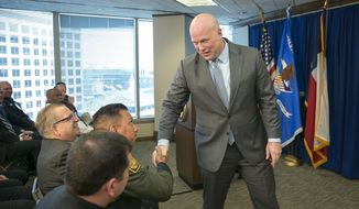 Acting U.S. Attorney General Matthew G. Whitaker shakes hands after speaking to area law enforcement officials at the U.S. Attorney's Office for the Western District of Texas in Austin, Tuesday, Dec. 11, 2018. (Jay Janner/Austin American-Statesman via AP) ** FILE **