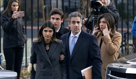 Michael Cohen, second from right, President Donald Trump's former lawyer, accompanied by his children from left, Samantha and Jake, and his wife Laura Shusterman, right, arrive at federal court for his sentencing for dodging taxes, lying to Congress and violating campaign finance laws in New York on Wednesday, Dec. 12, 2018. (AP Photo/Craig Ruttle)