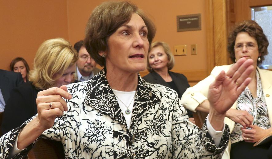 Kansas state Sen. Barbara Bollier, R-Mission Hills, makes a point during a meeting of fellow GOP senators, Thursday, April 26, 2018, at the Statehouse in Topeka, Kan. Kansas lawmakers are considering cutting income taxes to offset a revenue surplus tied to changes in federal tax laws. (AP Photo/John Hanna)