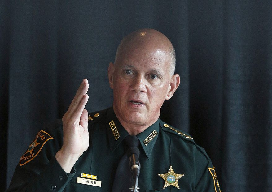 Pinellas County Sheriff Bob Gualtieri, the commission's chairman, pushed the measure, saying that most deaths in school shootings happen within the first few minutes, before officers responded. (Associated Press)