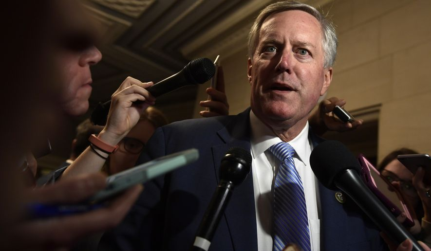 Rep. Mark Meadows, R-N.C., talks with reporters following a meeting on Capitol Hill in Washington, Wednesday, Nov. 14, 2018, for the House Republican leadership elections. (AP Photo/Susan Walsh)