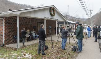The scene outside of the Salamy Memorial Center in Whitesville, W.Va., on Wednesday, December 12, 2018. Family and friends await word of the search teams efforts in finding Cody Beverly, Kayla Williams and Erica Treadway were reported missing Saturday night, and are stuck inside the Rock House Powellton mine. (Craig Hudson/The Charleston Gazette-Mail via AP)