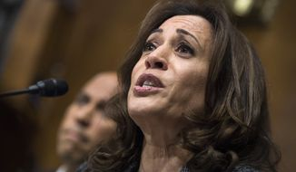 In this Sept. 27, 2018, photo, Sen. Kamala Harris, D-Calif., listens to Christine Blasey Ford testify during the Senate Judiciary Committee hearing on the nomination of Brett Kavanaugh to be an associate justice of the Supreme Court in Washington. (Tom Williams/Pool Photo via AP) **FILE**
