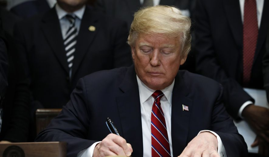 President Donald Trump signs an executive order establishing the White House Opportunity and Revitalization Council, in the Roosevelt Room of the White House, Wednesday, Dec. 12, 2018, in Washington. (AP Photo/Jacquelyn Martin) ** FILE **