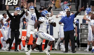 FILE - In this Dec. 1, 2018, file photo, Memphis running back Darrell Henderson runs for a touchdown against Central Florida during the first half of the American Athletic Conference championship game, in Orlando, Fla. Henderson was named to the 2018 AP All-America NCAA college football team, Monday, Dec. 10, 2018. (AP Photo/John Raoux, File)