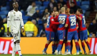 Real forward Vinicius Junior looks up as CSKA players celebrate in background their side's third goal, during the Champions League, Group G soccer match between Real Madrid and CSKA Moscow, at the Santiago Bernabeu stadium in Madrid, Spain, Wednesday Dec. 12, 2018. (AP Photo/Paul White)