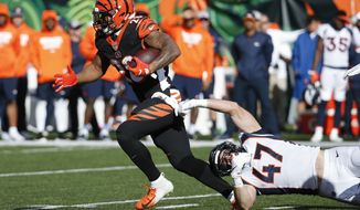 FILE - In this Dec. 2,2018, file photo, Cincinnati Bengals running back Joe Mixon (28) breaks a tackle-attempt by Denver Broncos inside linebacker Josey Jewell (47) in the first half of an NFL football game, in Cincinnati. Mixon has been one of the few bright spots during the Bengals' eight-game implosion. (AP Photo/Frank Victores, File)