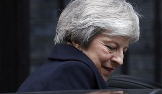 Britain's Prime Minister Theresa May leaves 10 Downing Street to attend the weekly Prime Ministers' Questions session, at parliament in London, Wednesday, Dec. 12, 2018. May has confirmed there will be a vote of confidence in her leadership of the Conservative Party, in Parliament Wednesday evening, with the result expected to be announced soon after.(AP Photo/Frank Augstein)